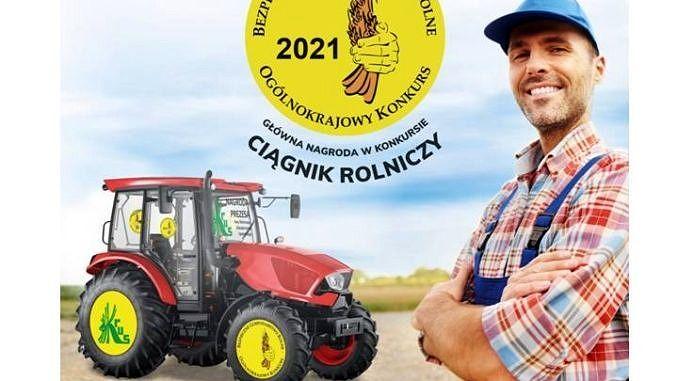 plakat - młody rolnik w kraciastej koszuli i w czapeczce niebieskiej z daszkiem obok ciągnik rolniczy; na górze żółte kółko a w nim napis Bezpieczne Gospodarstwo Rolne 2021 ogólnokrajowy konkurs