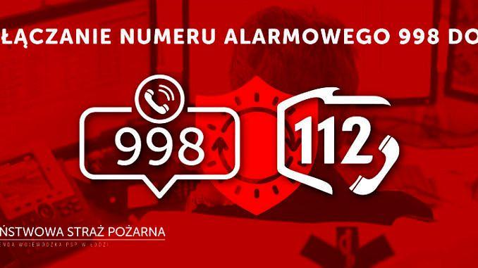 numer 998 i 112 na czerwonym tle
